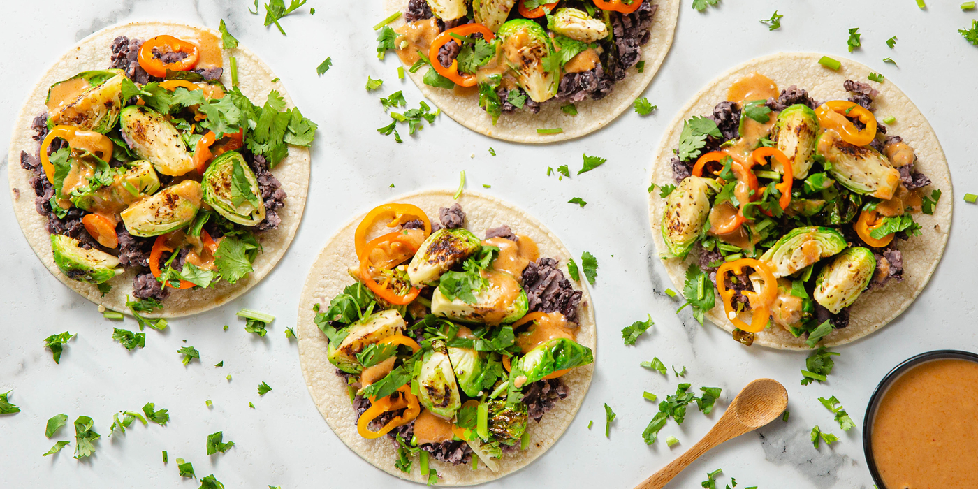 Charred Brussels Sprout Tacos with Spicy Peanut Dressing