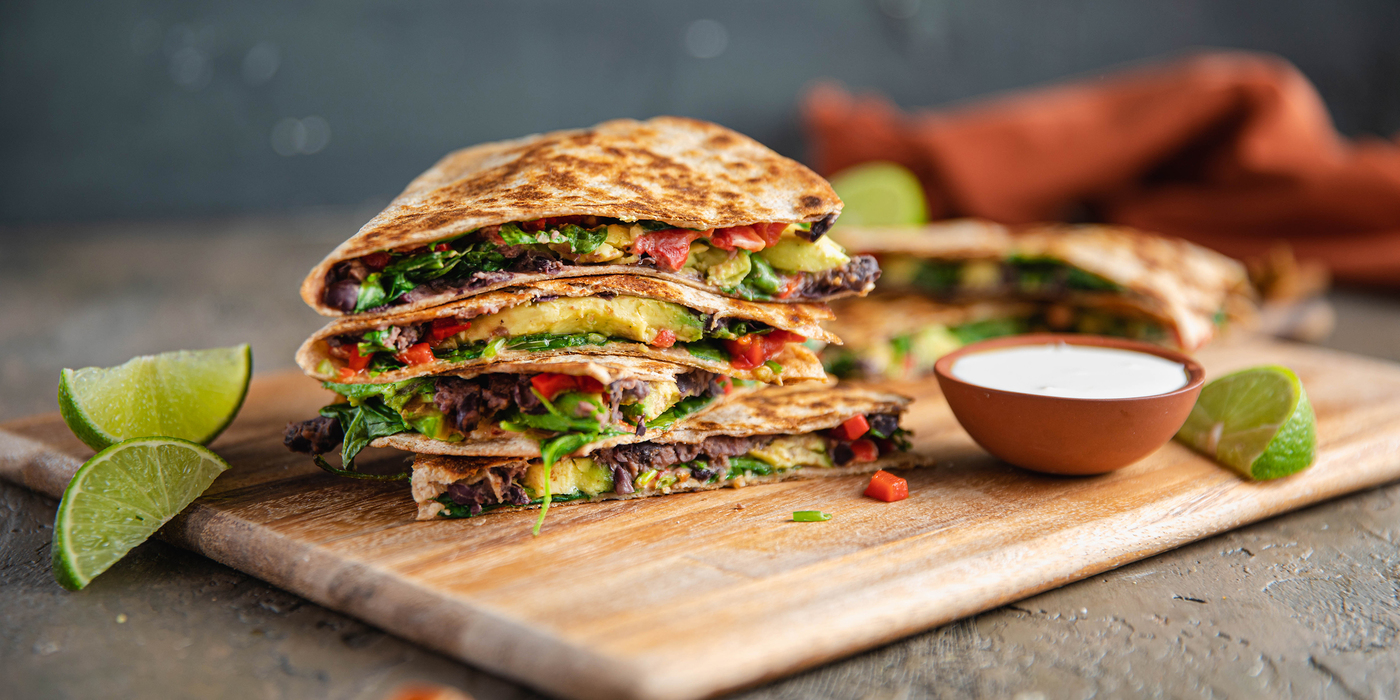 Roasted Red Pepper & Avocado Quesadillas with Refried Beans & Lime Crema