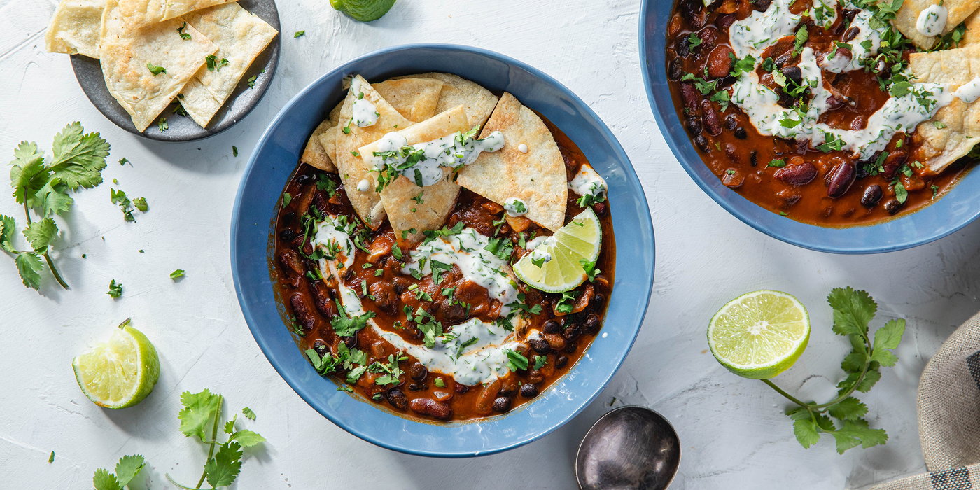 Smoky Two Bean Chili with Tortilla Chips & Cilantro Ranch Drizzle