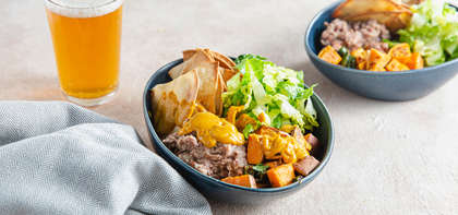 Roasted Vegetable Nacho Bowls with Refried Beans & Cashew Queso