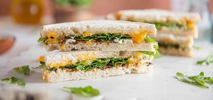 Cashew Cheese & Apricot Melts with Caramelized Onions & Arugula