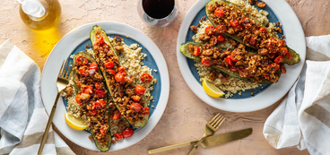 Tuscan Stuffed Zucchini with Herbed Sausage & Lemon Quinoa