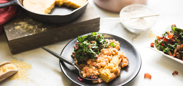 Southern Spoonbread with Black Eyed Pea Tomato Gravy & Greens