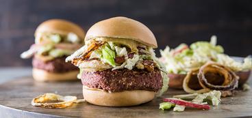Bean Burger with Crispy Onions and Peach Slaw