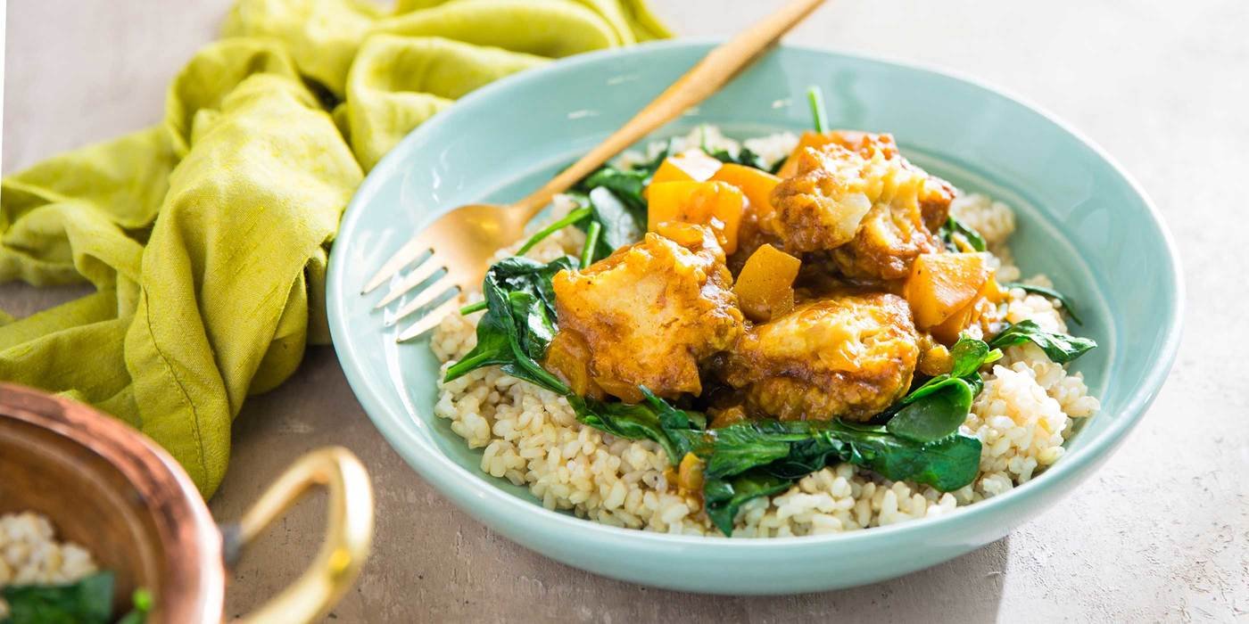 Mango Curry with Chickpea Dumplings and Spinach