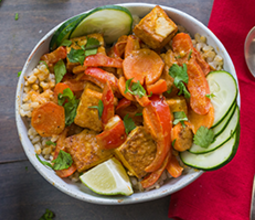 Peanut Tofu Buddha Bowl with Vegetables and Brown Rice image