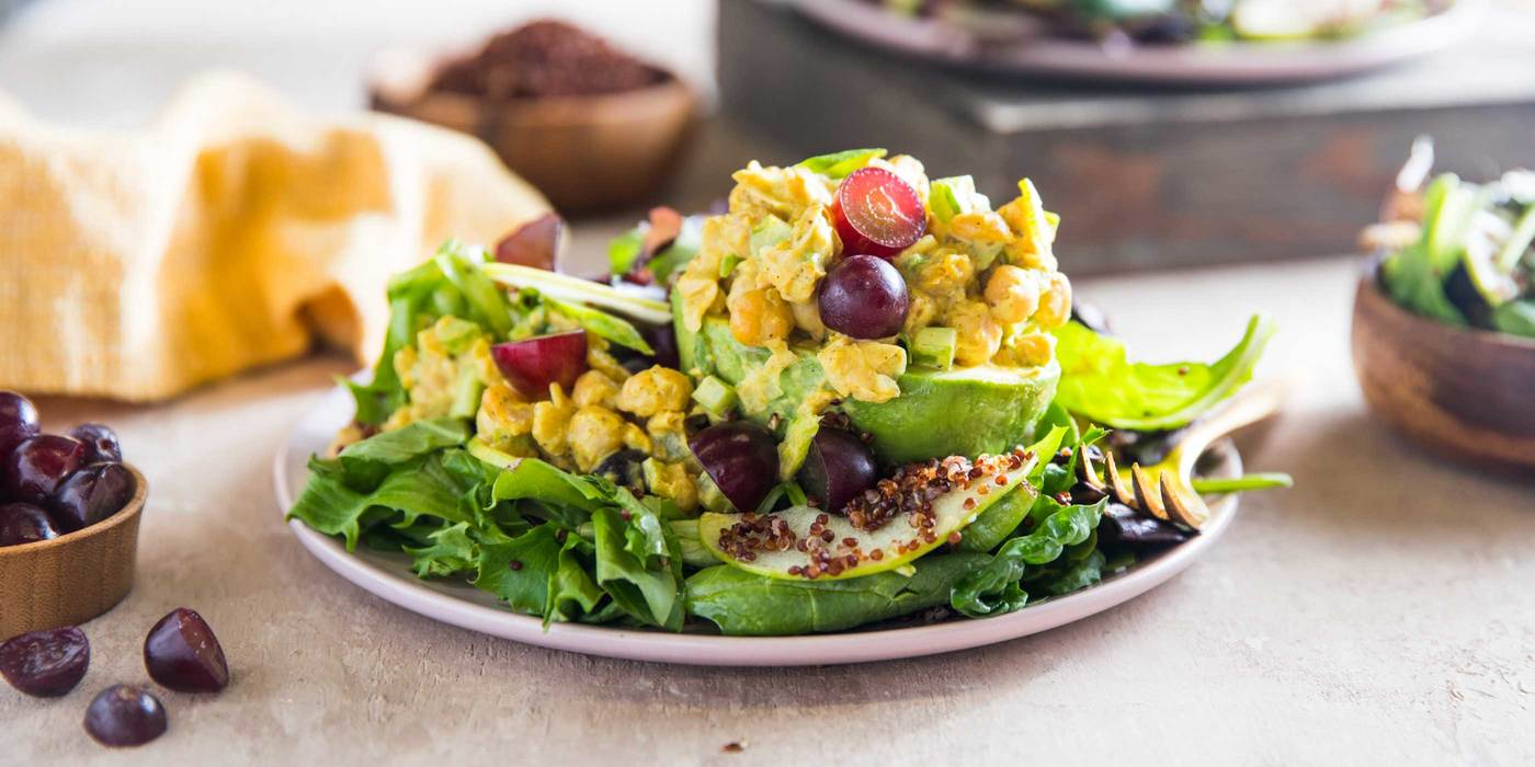 Chickpea Stuffed Avocado with Grapes and Red Quinoa