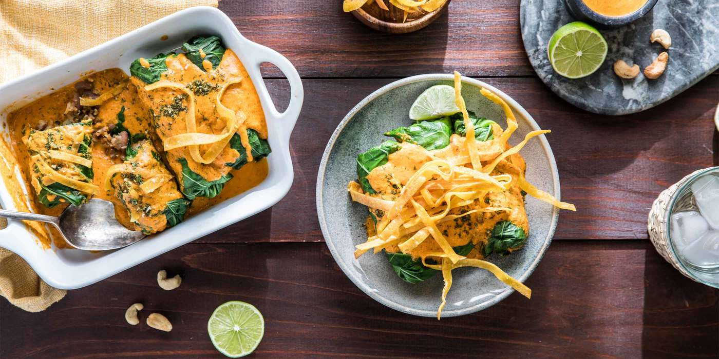 Collard Green Enchiladas with Spanish Rice and Creamy Red Pepper Sauce
