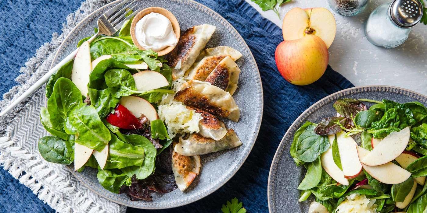 Pierogi-style Mushroom Dumplings with Sauerkraut & Apple Arugula Salad