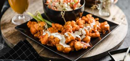 "Baked Mango Cauliflower Wings with ""Bleu Cheese"" Potato Salad"