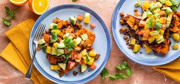 Taco Stuffed Sweet Potatoes with Crispy Seitan & Citrus Avocado Salsa