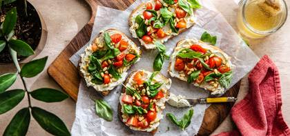 Creamy Cashew Cheese Toasts with Fresh Tomatoes & Pine Nuts