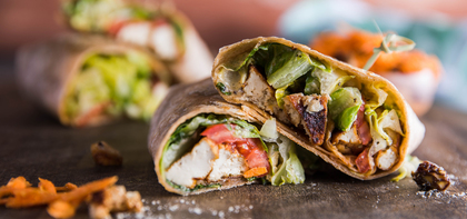 Smoky Tofu Caesar Wrap with Tomato & Carrot Raisin Slaw