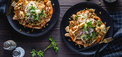 Cauliflower Steaks with Pepita Romesco Sauce & Crispy White Beans