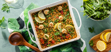 Baked Lemony Couscous with Tomatoes & Scallion Cashew Cheese