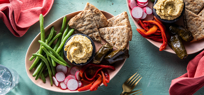 Hummus Bowls with Stuffed Grape Leaves & Roasted Red Peppers