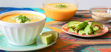 Creamy Coconut Carrot Soup with Avocado and Toasted Quinoa