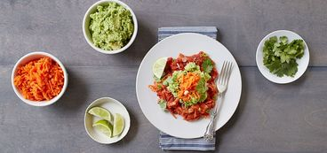 368 173 7a70 94f5 vegan chilaquiles with edamame guacamole and pickled carrots hero