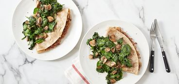 368 173 010c 5bd1 vegan caramelized onion crepes with warm spinach mushroom salad hero
