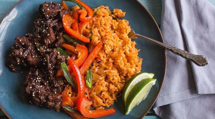 Dark Chocolate Mole Tempeh with Spanish Rice and Charred Peppers