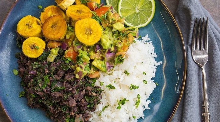 Black Bean and Kale Bowl with Roasted Plantains and Guacamole