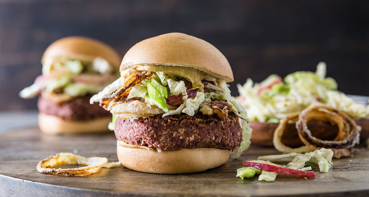 Bean Burger with Crispy Onions and Peach Slaw