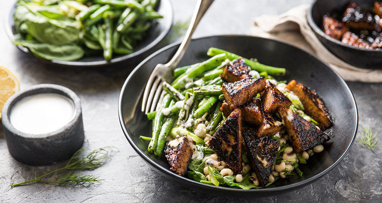 Pomegranate Glazed Tempeh with Dilly Black-Eyed Peas and Garlic Sauce
