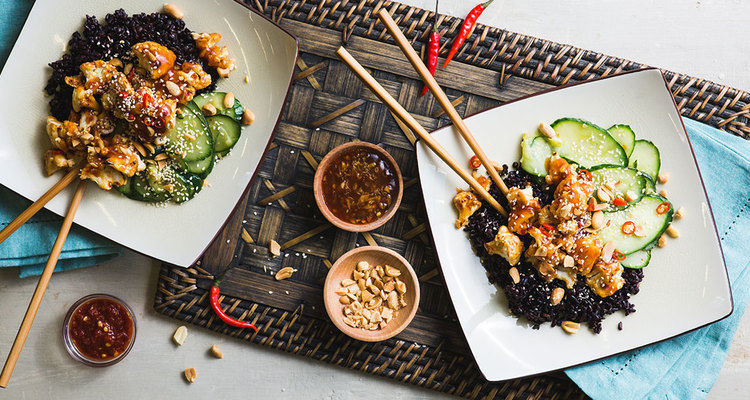 Kung Pao Cauliflower with Garlic Cucumbers and Midnight Grains