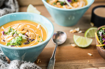 Butternut Bisque with Chipotle Crema and Kale Citrus Slaw