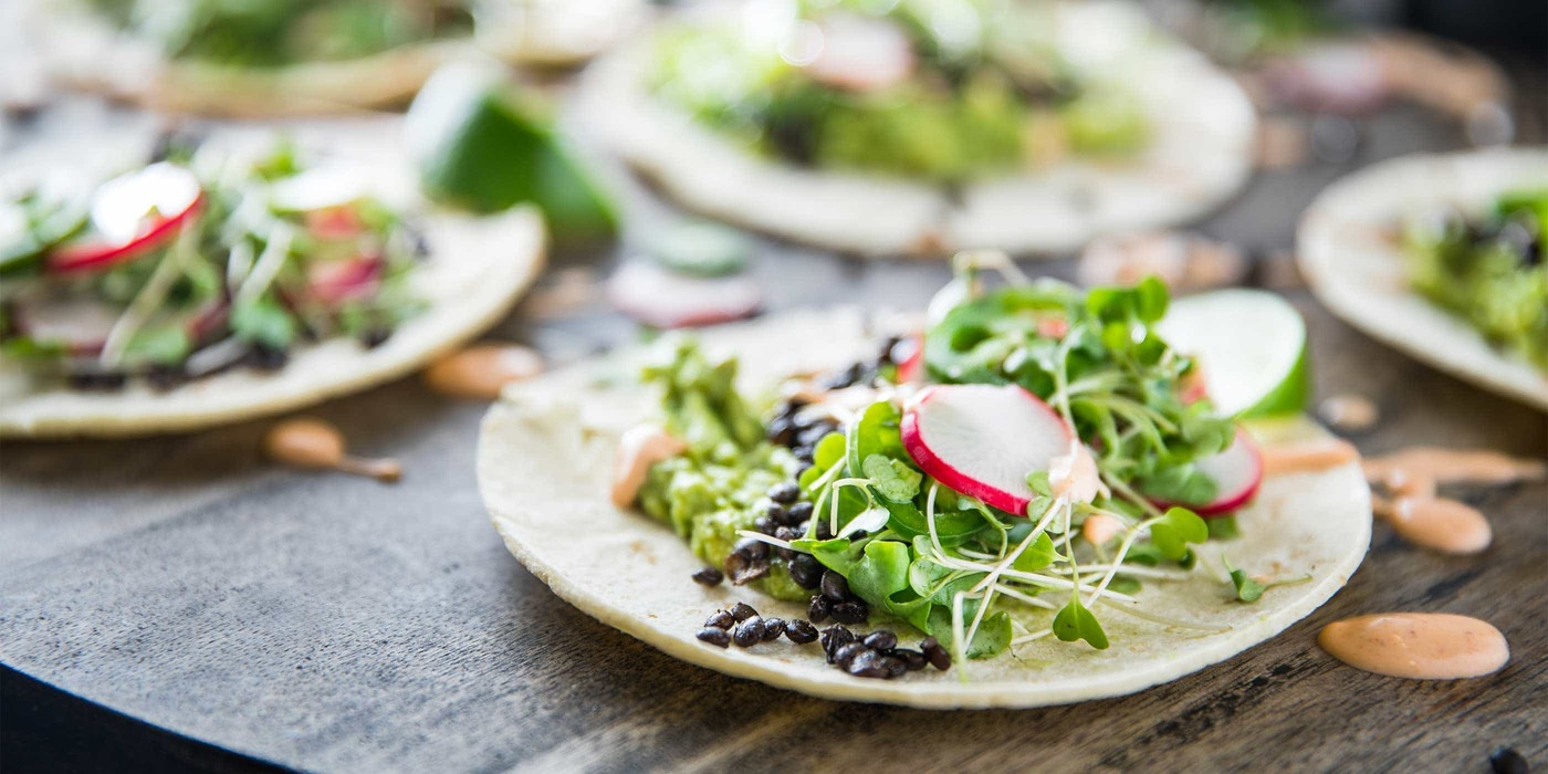 Beluga Lentil Taco with Quick Guacamole and Pea Shoot Slaw