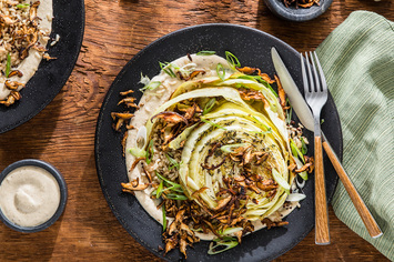Roasted Cabbage Steaks with Shiitake Bacon and Garlic Cream Sauce
